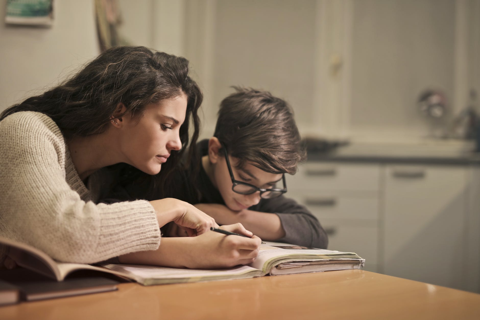 focused students doing homework at home