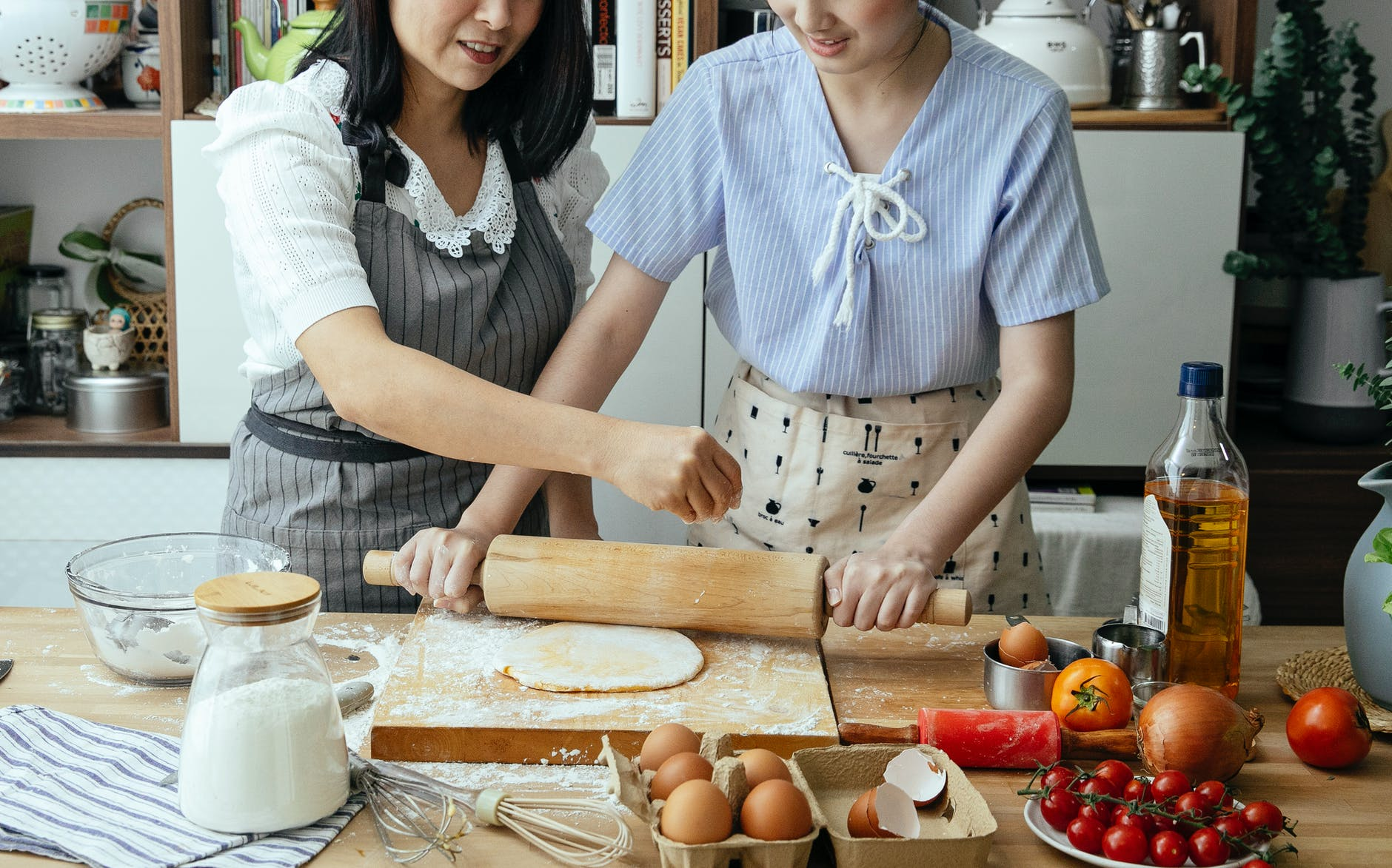 faceless women cooking together at home